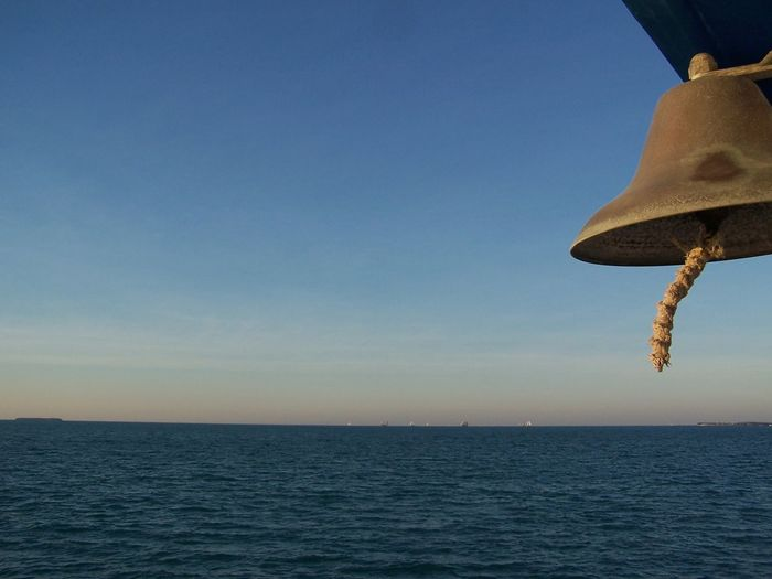 Nautical Ship Bell - At Sea Beauty In Nature Blue Sky Boat Clear Sky Florida Florida Keyes Florida Keys Horizon Over Water Key West Nature Nautical Nautical Bell Ocean Photography Sea Sea Photography Shades Of Blue Ship Sky Sky And Sea Blue Wave Sunset_collection Tranquil Scene Tranquility Water