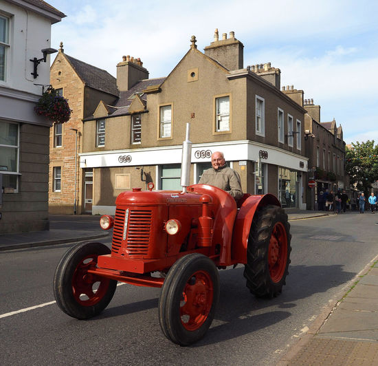 Kirkwall - Orkney Islands, Scotland Architecture People Real People Men Sky Red Day Outdoors Transportation Scottish Highlands Remote Location Antique Tractor Cloud - Sky Building Exterior Built Structure Orkney Islands A Taste Of Scotland Bleak And Cold High Street Kirkwall Man On Tractor Tractor On Public Road Holiday Moments