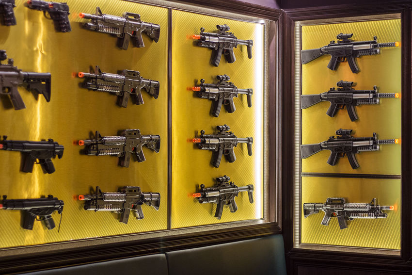 Concept of Gun Control. Collection of Toy Guns Displaying on a Wall instead of Real Guns Violence Weapon Killing Safety Protection Trıgger No People In A Row Design Pattern Background Enforcement Firearm Equipments Rack Reload Room
