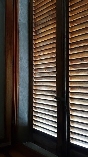 Vertical And Horizontal Lines Blue And Brown Window Shutter Sunlight Through Window Shutter Indoors  No People No Filter, No Edit, Just Photography Close-up Of Window Open Window Wodden Window Shutter