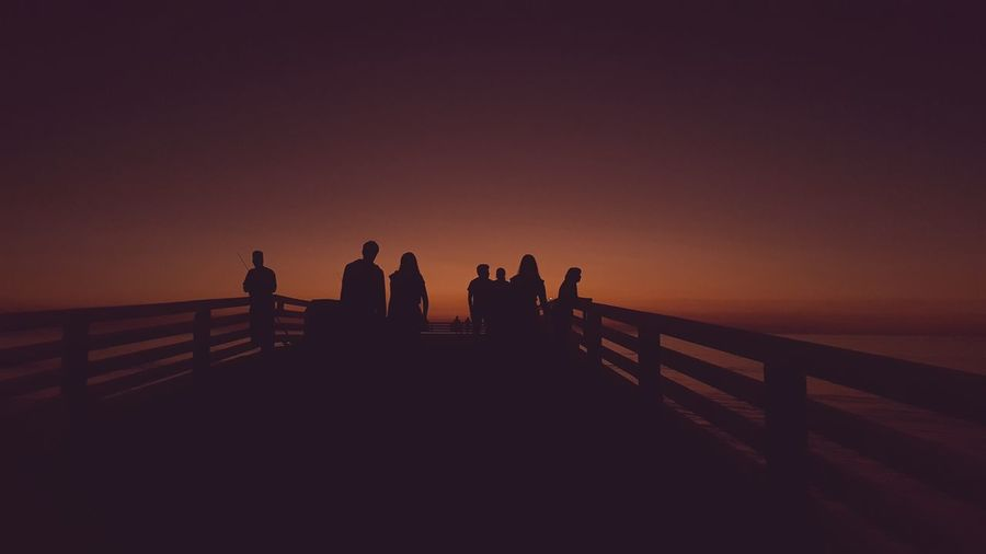 Sunset Silhouette People Vacations Adult Sea Outdoors Women Sky Nature Friendship Adults Only Astronomy Day Lights And Shadows Vacations Nature Night Clear Sky Beach Tranquility Scenics San Diego Sunset_collection Pier