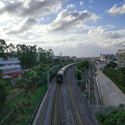 Transportation Railroad Track Rail Transportation Sky Cloud - Sky Architecture Built Structure The Way Forward MIphotography High Angle View Railway Track No People Public Transportation Day Tree Outdoors Building Exterior Nature City