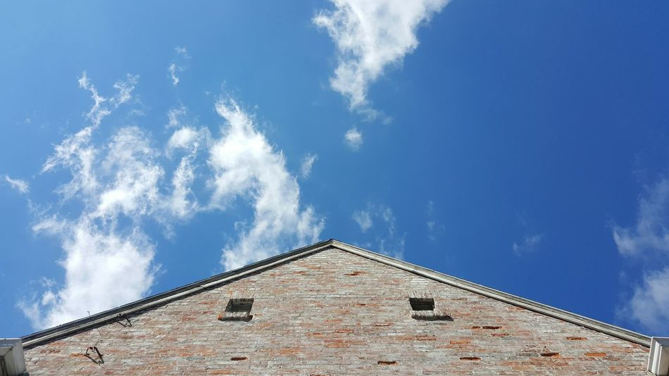 Sky Low Angle View Built Structure Outdoors Architecture Day Blue Sky Perspective Roof Brick Wall Part Of A House Abstract Old Painted Bricks Blue And White White Clouds Crisp Fresh Looking Up Pointed To The Sky Edges