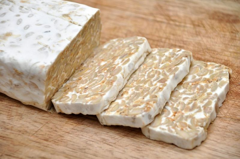 Tempe, traditional soy product originally from Indonesia. Its made by a natural culturing and controlled fermentation proccess that binds soybeans into a cake form. Tempe Tempeh Food Foods Indonesian Food Traditional Food Fermentation Foods Healthy Food Protein