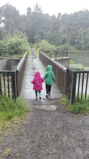 Walking In The Rain It's Only Rain! My Kids Sibling Love Holding Hands Adventure Buddies Adventurers Walking With Family Outdoors Fun In The Rain Place Of Heart The Portraitist - 2017 EyeEm Awards