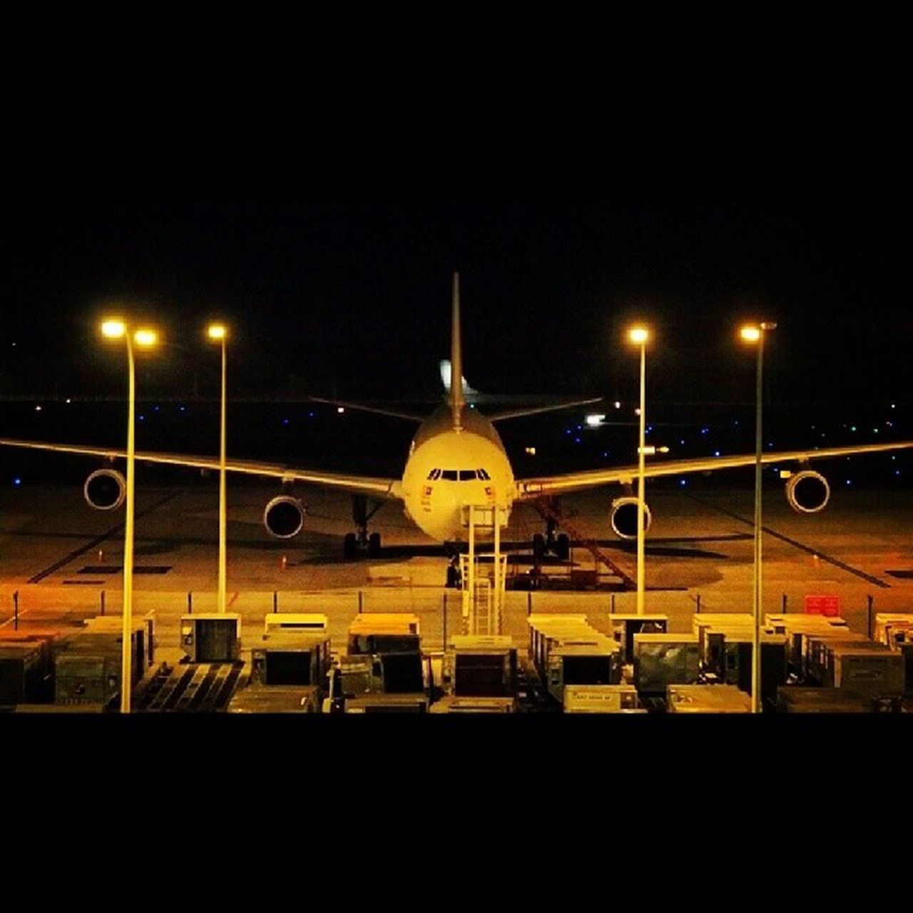 night, transportation, illuminated, airplane, airport, mode of transport, public transportation, sky, built structure, no people, building exterior, airport runway, architecture, outdoors