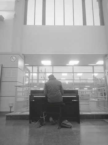 One Man Only One Person Only Men Adults Only Men Occupation People Check This Out From My Point Of View Blackandwhite Black And White Black & White Blackandwhite Photography Piano Piano Keys Pianist Piano Time Piano Key Station Train Station Music Musician Unknown Adult Architecture