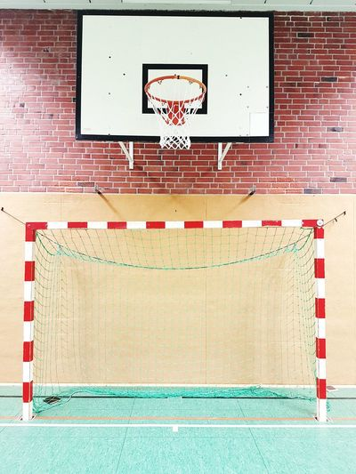 View of basketball hoop against brick wall