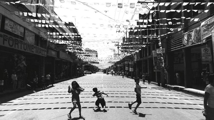 Street playground. Enjoying Life Summer Portrait Kadayawanfestival People Photography The Traveler - 2015 EyeEm Awards Eyeem Philippines EyeEm Best Shots - Black + White Eyeem Shades Of Gray Blackandwhite Photography Creative Light And Shadow 2015 Eyeem Awards