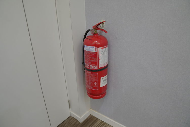 High angle view of red container on wall