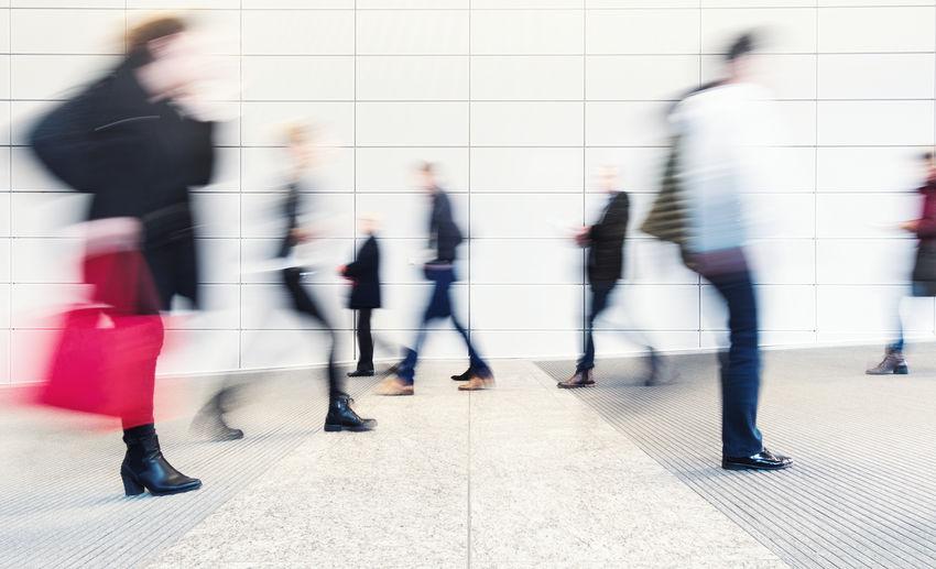 Blurred Motion Of People Walking On Street