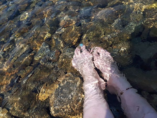 EyeEm Selects Low Section Water Swimming UnderSea Swimming Pool Underwater Women Shadow Human Leg High Angle View Foot Feet Shore Rippled Ankle Deep In Water Human Feet Pebble Beach Calm Leg Toe Human Foot Human