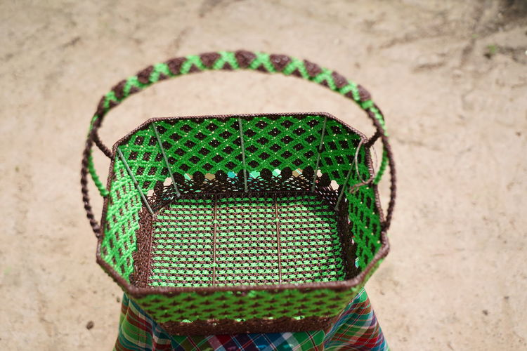 High angle view of wicker basket on wall