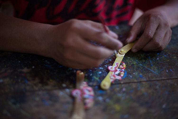 Midsection of craftsperson in workshop