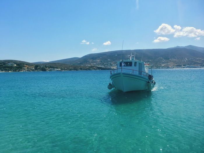 Transportation Water Nautical Vessel Blue Sky Sea Mode Of Transport Day Mountain Nature Beauty In Nature Outdoors Scenics No People Waterfront Sailing Martselobeach Greece Paros Boat