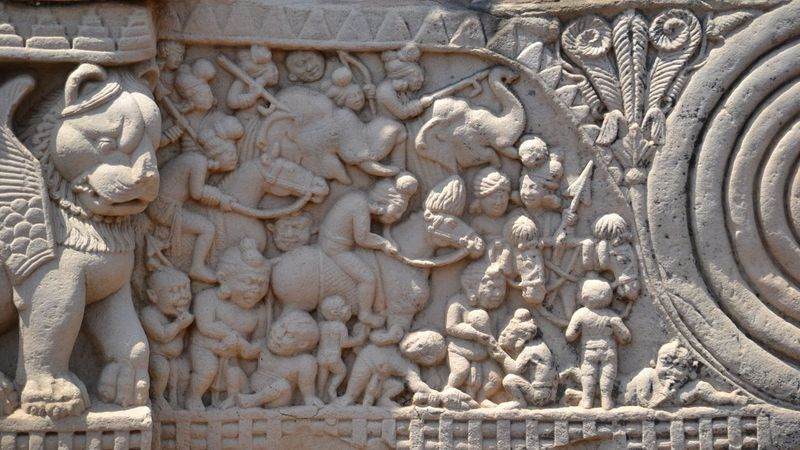 Art And Craft Sculpture Statue Human Representation Carving - Craft Product Stone Material Bas Relief History Travel Destinations Day Ancient Archaeology Outdoors Tourism No People Architecture Place Of Worship Built Structure Ancient Civilization Sanchi India