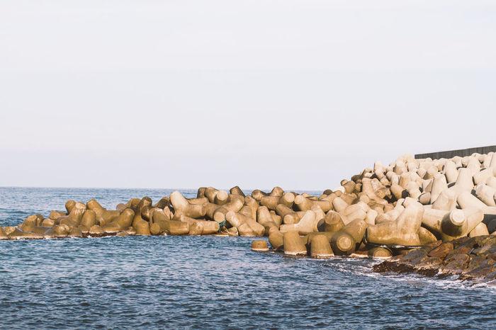 Tetrapod in the beach for protection Beach Coastline Construction Construction Site Jetty Ocean Pier Protection Safe Sea Sea And Sky Seascape Seascapes Seaside Shore Stone Strong Summer Tetrapod