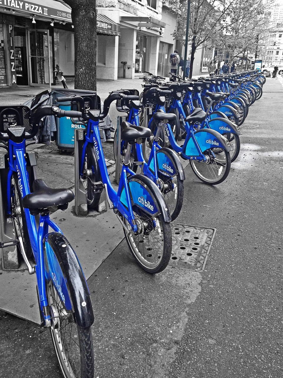 bicycle, transportation, mode of transport, stationary, parking, land vehicle, bicycle rack, in a row, architecture, street, built structure, no people, day, outdoors, building exterior, road, city, tire