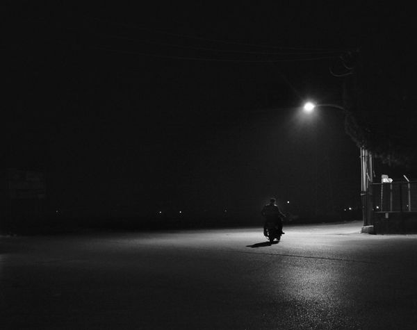Turning to home Lonely Motorcycle Street Illuminated Full Length Real People People Stories From The City The Street Photographer - 2018 EyeEm Awards HUAWEI Photo Award: After Dark #urbanana: The Urban Playground