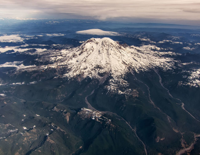 Aerial view of Mt. Rainier. Mt. Rainier Aerial View Beauty In Nature Birds Eye View Cloud - Sky Day Landscape Mountain Nature No Drone Required No People Outdoors Scenics Sky Tranquil Scene Tranquility Travel Destinations Volcano