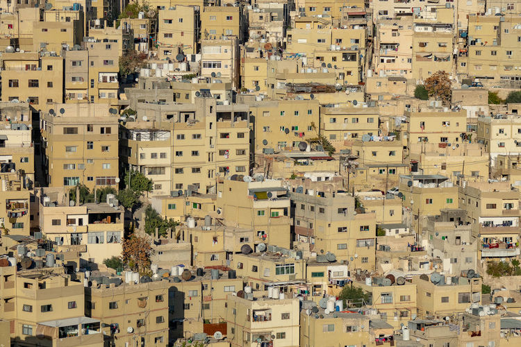 High angle view of residential buildings in city in jordan