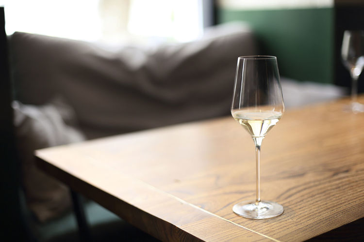 Glass of wine on table