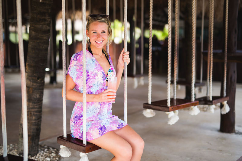 Adult Adults Only Bar Beautiful Woman Cheerful Day Drink Happiness Lifestyles Looking At Camera One Person Outdoors People Portrait Real People Smiling Swing Young Adult Young Women