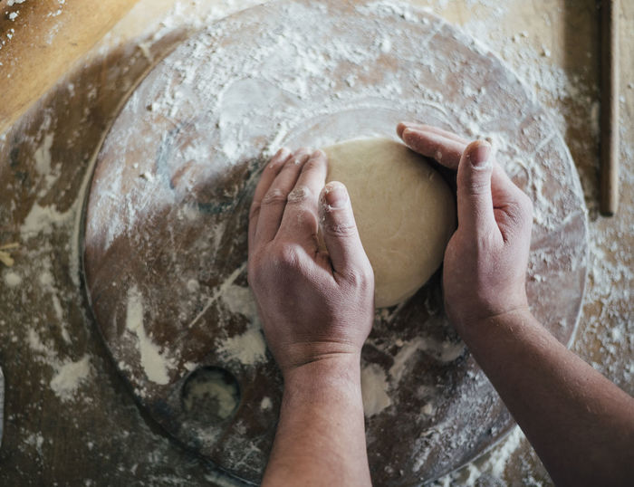 Baking bread Cooking Cooking At Home Cuisine Loaf Of Bread Plant Baked Beauty In Nature Bread Dough Flour Food Food And Drink Gastronomy High Angle View Home Made Kitchen Kneading Making Pizza Preparation  Preparing Food Real People Recipe Traditional
