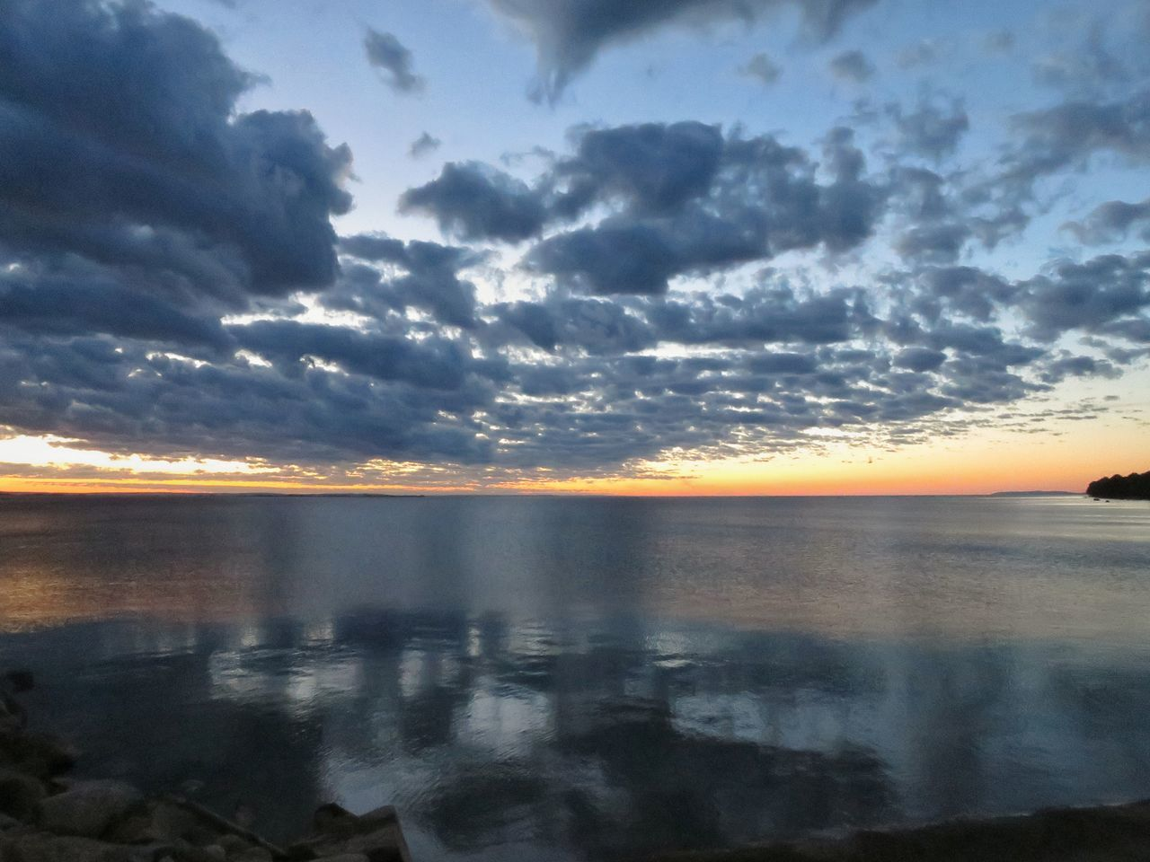 sunset, scenics, sky, nature, tranquility, beauty in nature, water, cloud - sky, tranquil scene, sea, reflection, no people, idyllic, outdoors, horizon over water, storm cloud, day
