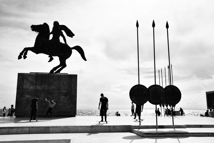 Time stood still Statue Streetphotography Silhouette Eye4photography  EyeEm Gallery EyeEm Best Shots Human Representation Shadows b&w street photography B&w Real People Still Capture The Moment Youth People Learn & Shoot: Balancing Elements Learn & Shoot: Leading Lines City Life City Street Men Statue Sculpture Silhouette Horseback Riding Horse Politics And Government Sky Cloud - Sky King - Royal Person Street Art