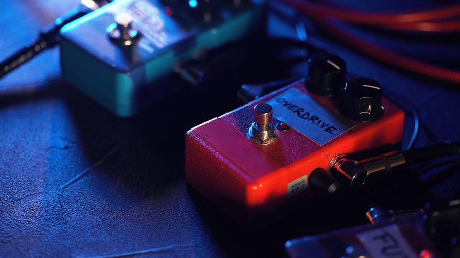 Close up of guitar pedals. music effect loop machine. Close-up Blue Technology Indoors  No People Connection Selective Focus Still Life Red Communication Equipment High Angle View Cable Electric Plug Electricity  Focus On Foreground Table Fuel And Power Generation Record Electrical Equipment