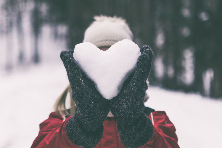 Close-Up Of Woman Holding Snow