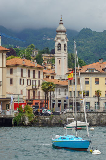 Menaggio on Lake Como in Italy Building Exterior Architecture Built Structure Nautical Vessel Water Mode Of Transportation Building Nature Waterfront Sailboat Outdoors TOWNSCAPE No People City Day Travel Destinations Lake Como Italy Fog