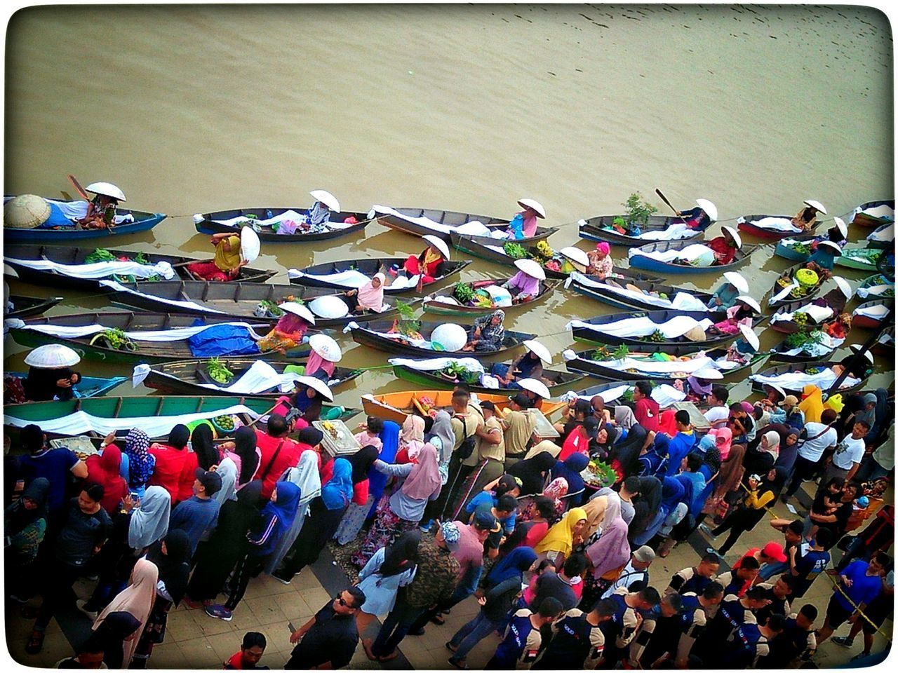 group of people, large group of people, crowd, real people, high angle view, day, men, multi colored, transfer print, water, auto post production filter, togetherness, leisure activity, nautical vessel, outdoors, transportation, lifestyles, nature