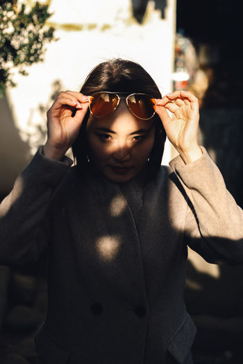 Streetphotography Sunset Shadow Shadows & Lights Tbilisi Asian  EyeEm Best Shots Alexruadzephotography One Person Front View Real People Focus On Foreground Lifestyles Portrait Leisure Activity Standing Glasses Sunglasses Waist Up Looking At Camera Fashion Casual Clothing Men Hand In Hair Sunlight Holding Day Outdoors