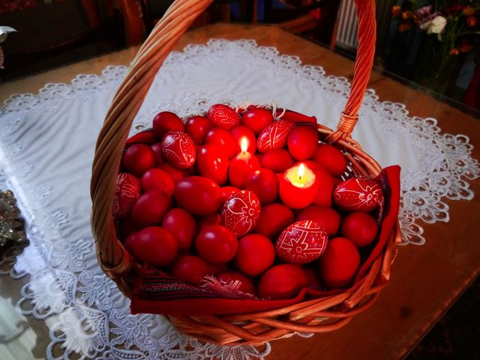 High angle view of strawberries in basket on table