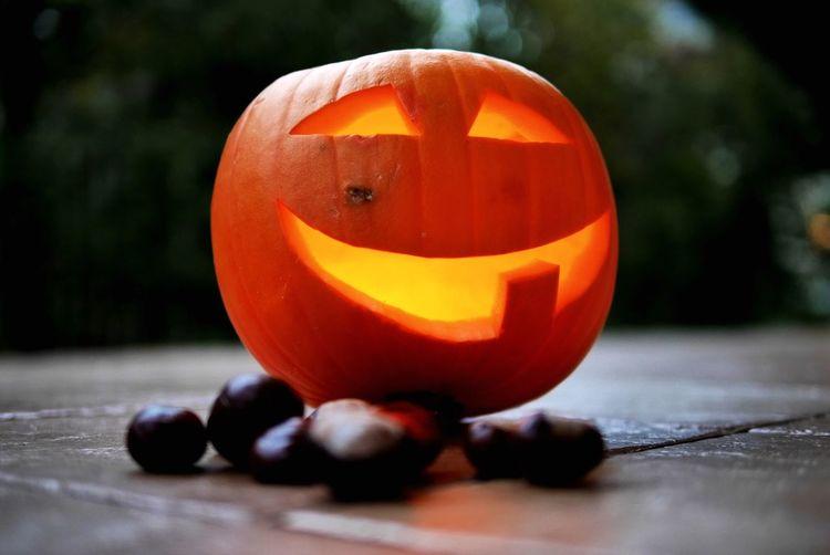 Close-up of pumpkin against orange halloween