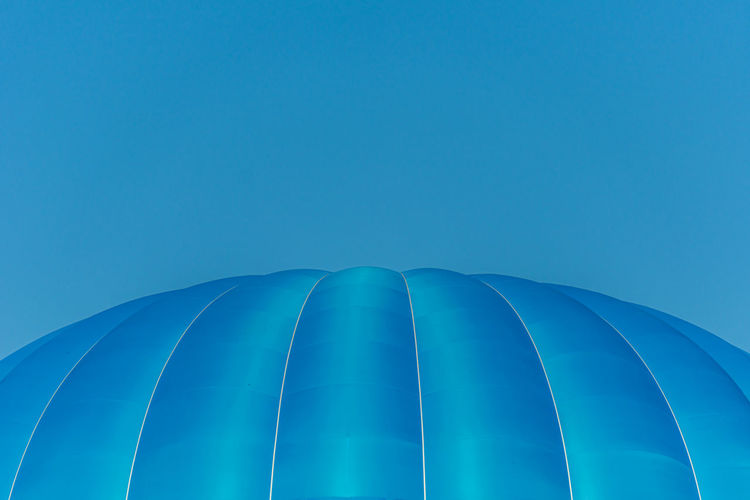 Low angle view of blue hot air balloon against blue sky