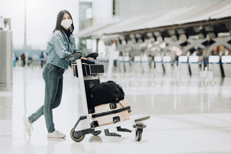 Side view of woman standing at airport