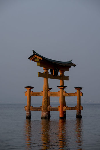 Architectural Column Architecture Belief Built Structure Clear Sky Day Horizon Horizon Over Water Nature No People Religion Scenics - Nature Sea Shrine Sky Spirituality Tranquil Scene Tranquility Water Waterfront Wood - Material