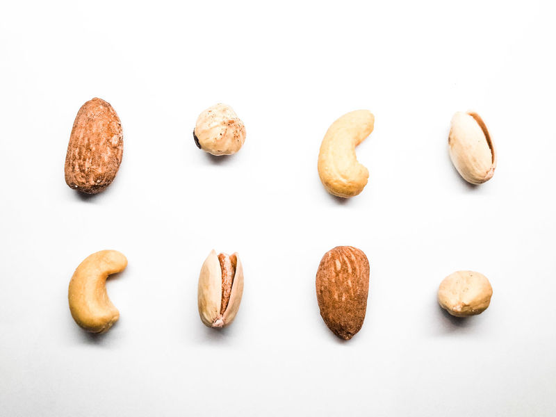 Mix of nuts in two rows order in pastel colors Nuts Nut - Food Healthy Eating Health Healthy Lifestyle Healthy Food Order Orderly Ordered Ordered Objets Rows Food Foodphotography White Background Nut - Food Studio Shot Close-up Food And Drink Almond Pistachio Cashew Hazelnut Nutshell Salted Dried Food Nut