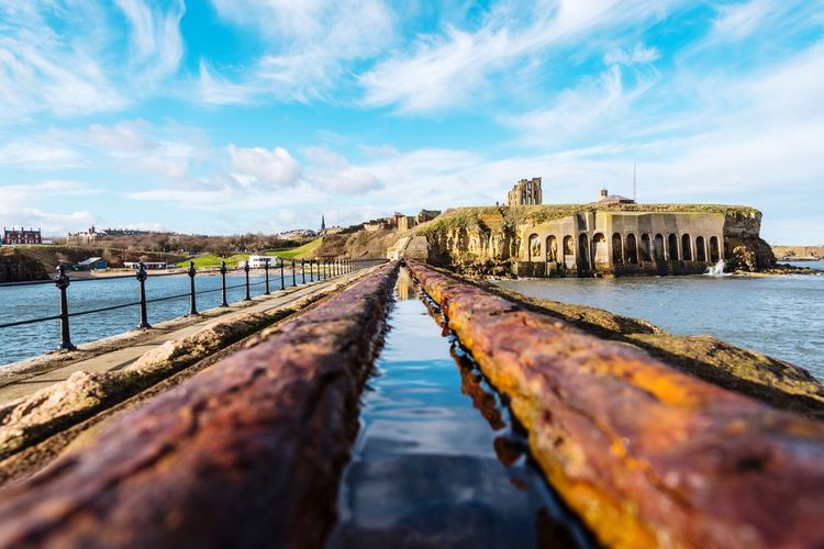 Tynemouth Ruins Of A Castle Ruins Castle Reflection Nikon Northeast Perspective EyeEm Masterclass Pier EyeEm Selects Water Sky Architecture Built Structure Cloud - Sky Day Outdoors The Way Forward History Nature Beauty In Nature Scenics