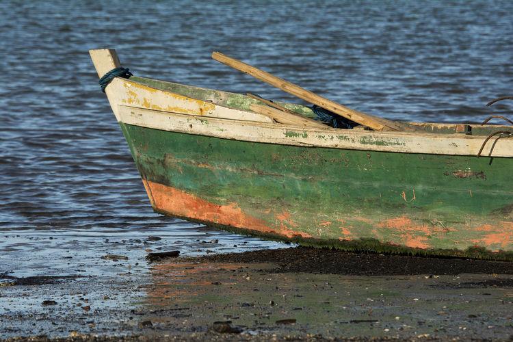 at the beach in Porto Seguro, Bahia, Brazil, a beach called Ponta Grande Barco Barco De Pesca Beach Boat Brazil Design Deterioration Fine Art Photography Fishing Boat Mode Of Transport Outdoors Sea Simplicity
