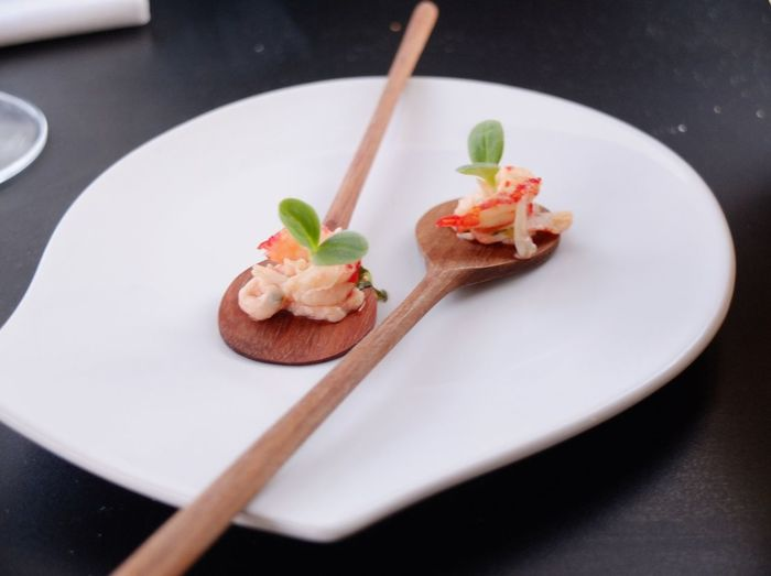 Close-up of prawns on wooden spoons