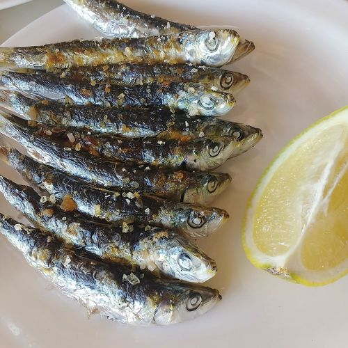grilled salted sardines tapas in spain Sardines Grilled Sardine Seafood Grilled Fish Fish In Salt Bbq Fish SPAIN Tapas Fish Tapa Tapa Fish By The Sea White Plate Lemon Indulgence Rock Salt Delicious Yummy Finger Licking Good