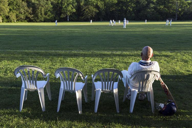 Next In Line Village Cricket Ground Cricket Bat English Game English Pastime Plastic Chairs Village Cricket Willow