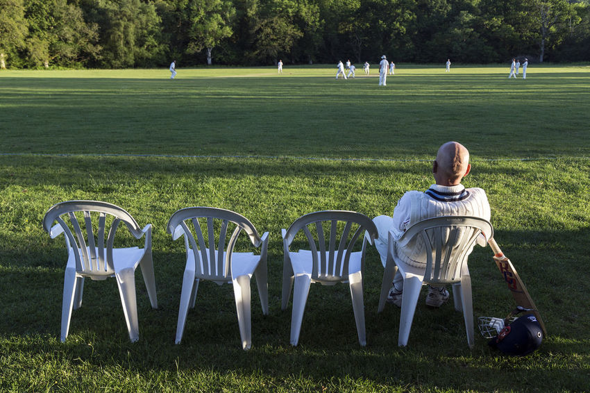 Next In Line Village Cricket Ground Cricket Bat English Game English Pastime Plastic Chairs Village Cricket Willow
