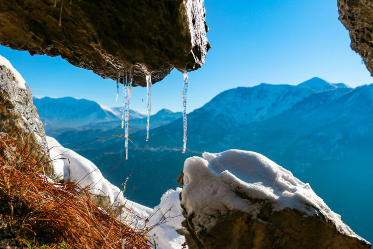 Scenic view of frozen lake against mountains
