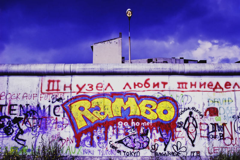 'Rambo' mural on original Berlin Wall in the 1980's 'Rambo' Berlin Wall Communism East-West Graffiti History Mural Original Political Socialism