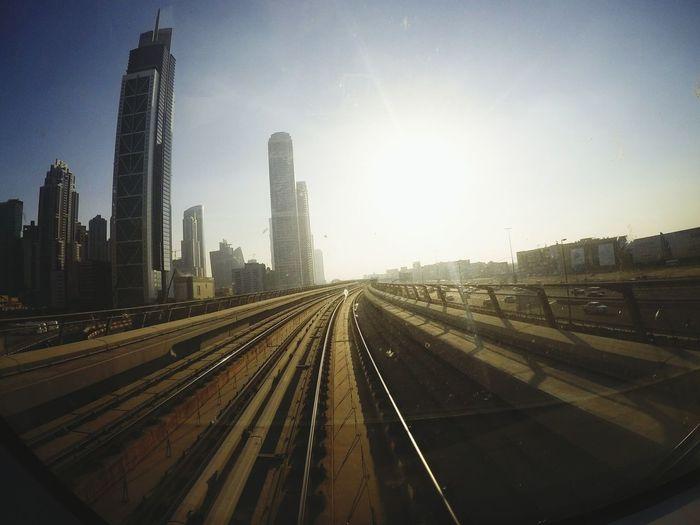 Railroad Tracks On Bridge In City Against Sky